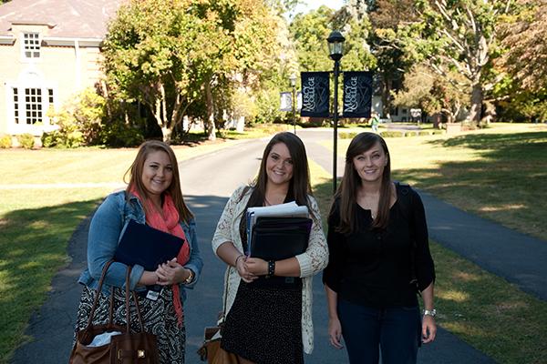Female mercy students outside Verrazzano Hall